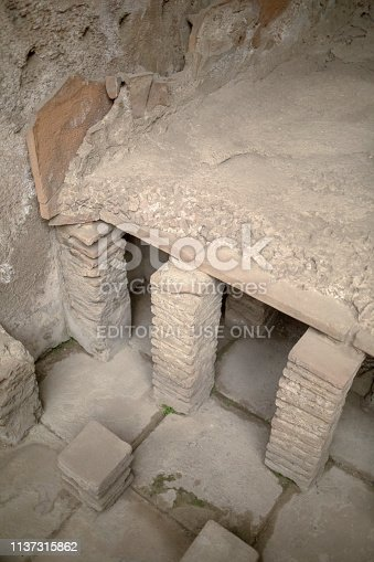 Hypocaust (Roman Central Heating System) under the floor of a Roman building in Pompeii. It circulates hot air below the floor of a room from a central wood fire furnace.
