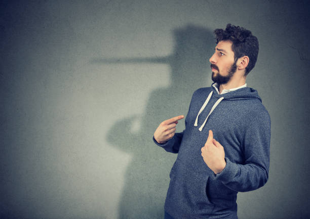 Hypocritical man lying expressively Side view of elegant man looking surprised when being caught on lie. dishonesty stock pictures, royalty-free photos & images