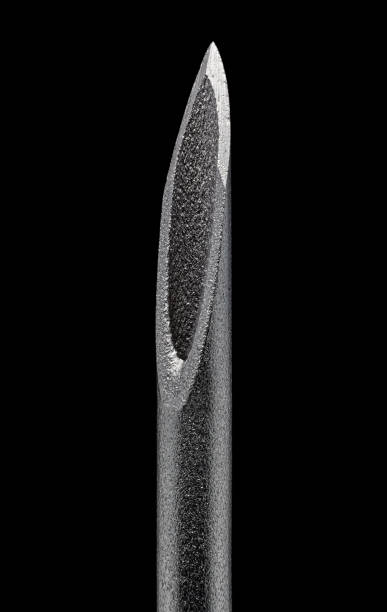 Hypodermic syringe needle under the microscope macro close-up, isolated on black background with clipping path. stock photo