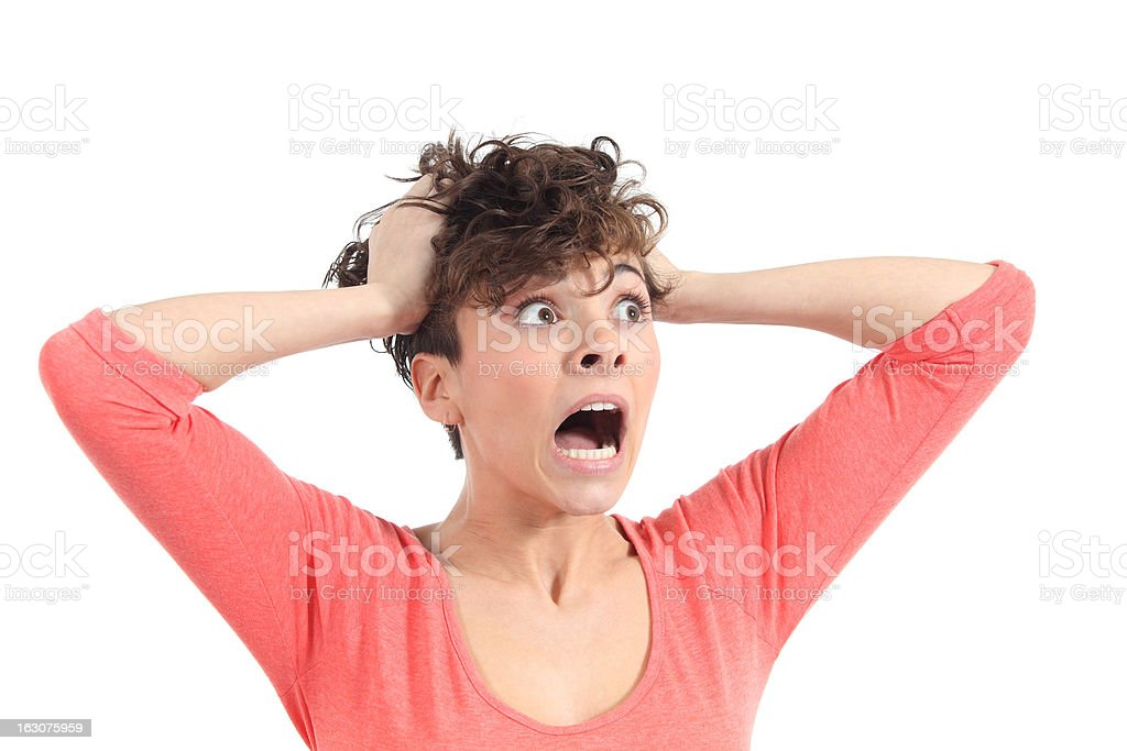 Hysterical woman expression with her hands on the head stock photo
