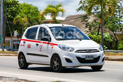 Tulum, Mexico - May 17, 2017: White taxi car Hyundai i10 in the city street.