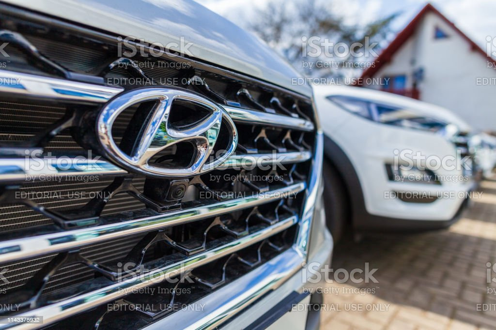 Hyundai logo on a Hyundai car at a car dealer Nuremberg / Germany - April 7, 2019: Hyundai logo on a Hyundai car at a car dealer. The Hyundai Motor Company is a South Korean multinational automotive manufacturer headquartered in Seoul. Advertisement Stock Photo
