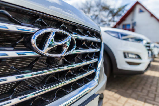 Hyundai logo on a Hyundai car at a car dealer Nuremberg / Germany - April 7, 2019: Hyundai logo on a Hyundai car at a car dealer. The Hyundai Motor Company is a South Korean multinational automotive manufacturer headquartered in Seoul. brand name stock pictures, royalty-free photos & images