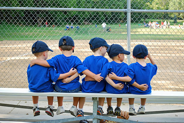 i love my team five little boys put their arms around each other befor their baseball game baseball sport stock pictures, royalty-free photos & images