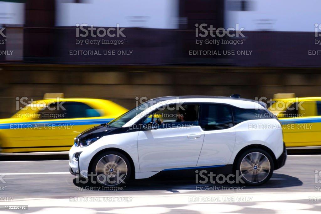 BMW i3 five-door urban electric car driving in the city of Funchal at Madeira island - Foto stock royalty-free di Affari finanza e industria