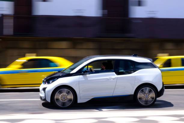 BMW i3 five-door urban electric car driving in the city of Funchal at Madeira island stock photo