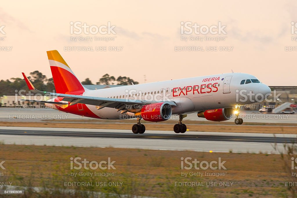 Iberia Express in new livery on landing stock photo