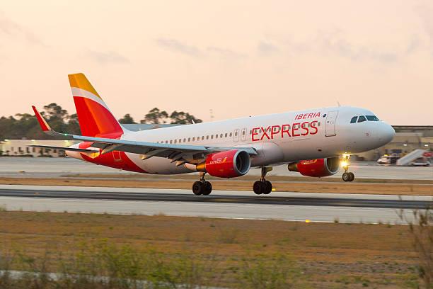 iberia express in new livery on landing - 이베리아 반도 뉴스 사진 이미지