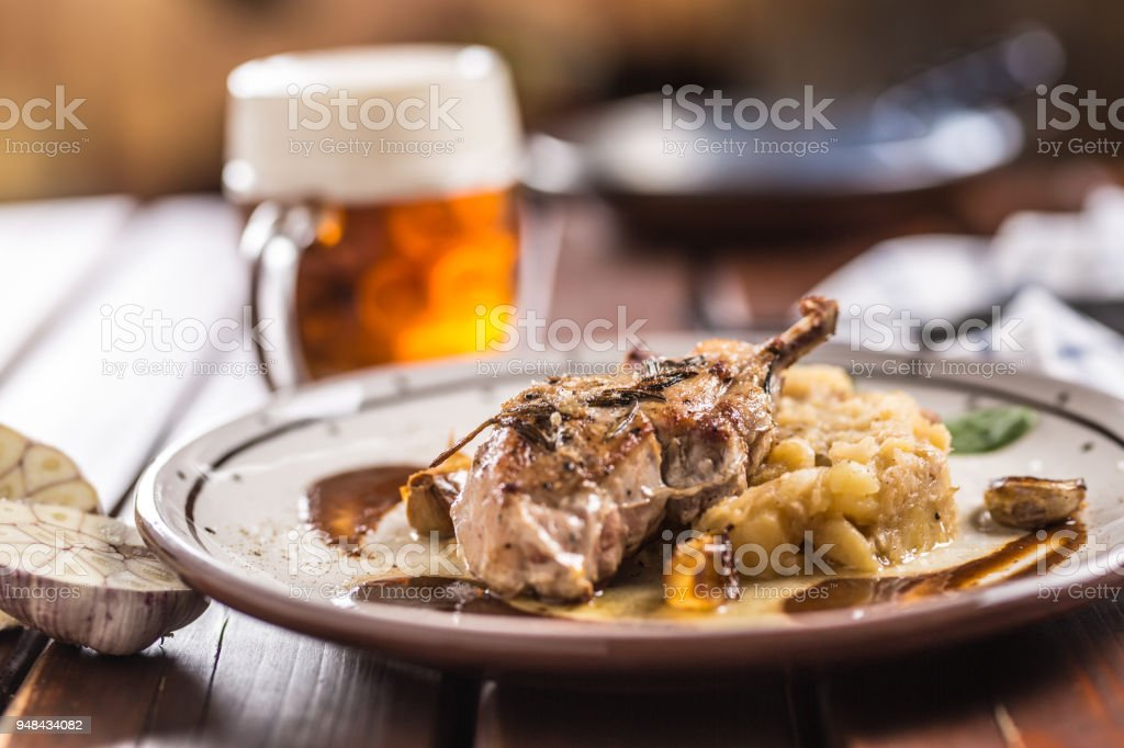 Iberian cutlet with mashes potatoes decoration and draft beere in pub or restaurant stock photo