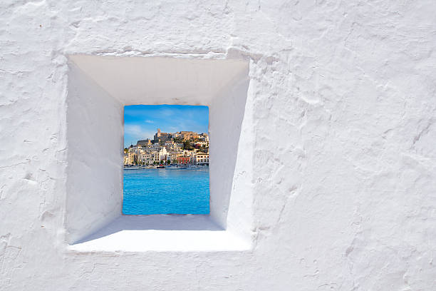 Ibiza mediterranean white wall window stock photo