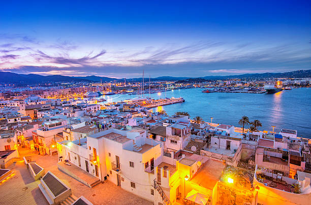 Ibiza Old Town and Harbour at dusk stock photo