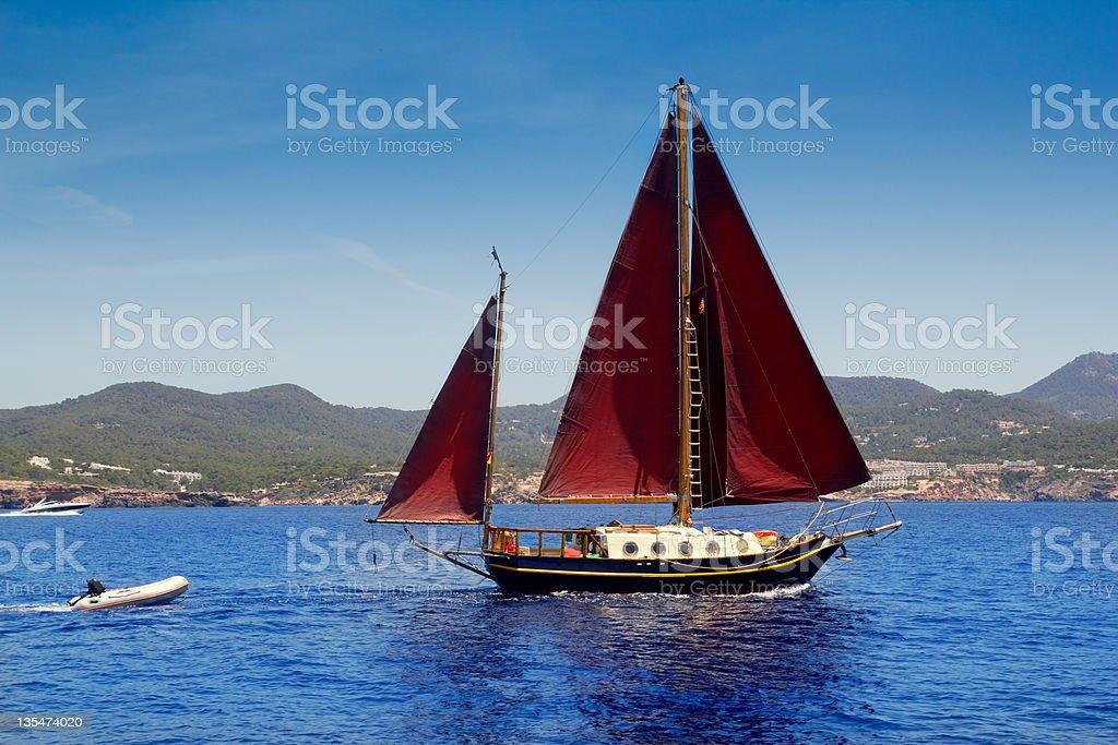 Ibiza Red sails sailboat in Sa Talaia coast royalty-free stock photo