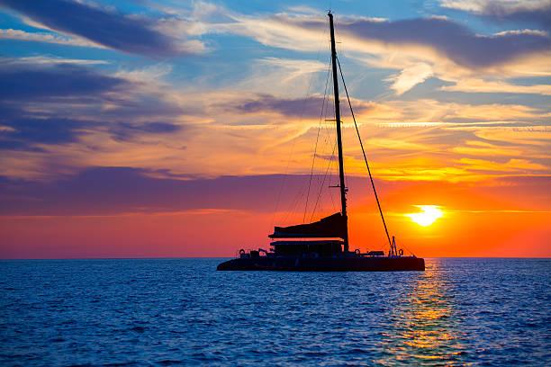 ibiza san antonio abad catamaran sailboat sunset - katamaran bildbanksfoton och bilder