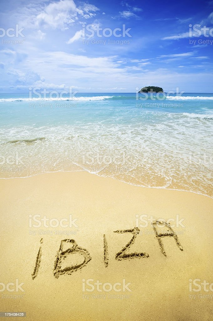 Ibiza written in the sand of a tropical beach royalty-free stock photo