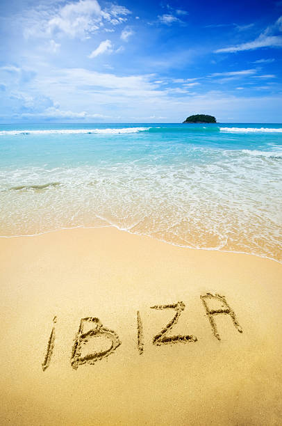 Ibiza written in the sand of a tropical beach stock photo
