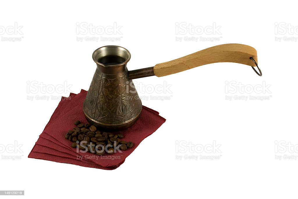 Ibrik on a serviette with coffee beans royalty-free stock photo