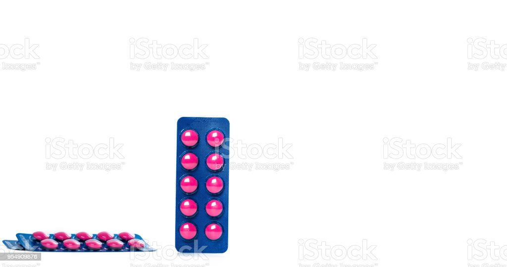 Ibuprofen in pink tablet pills pack in blue blister pack isolated on white background with copy space. Ibuprofen for relief pain, headache, high fever and anti-inflammatory. Painkiller tablets pills. stock photo