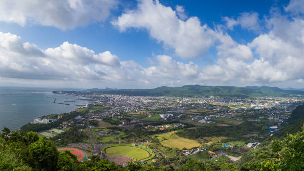 ibusuki town skyline and blue sky from hill top - satoyama scenery stock photos and pictures