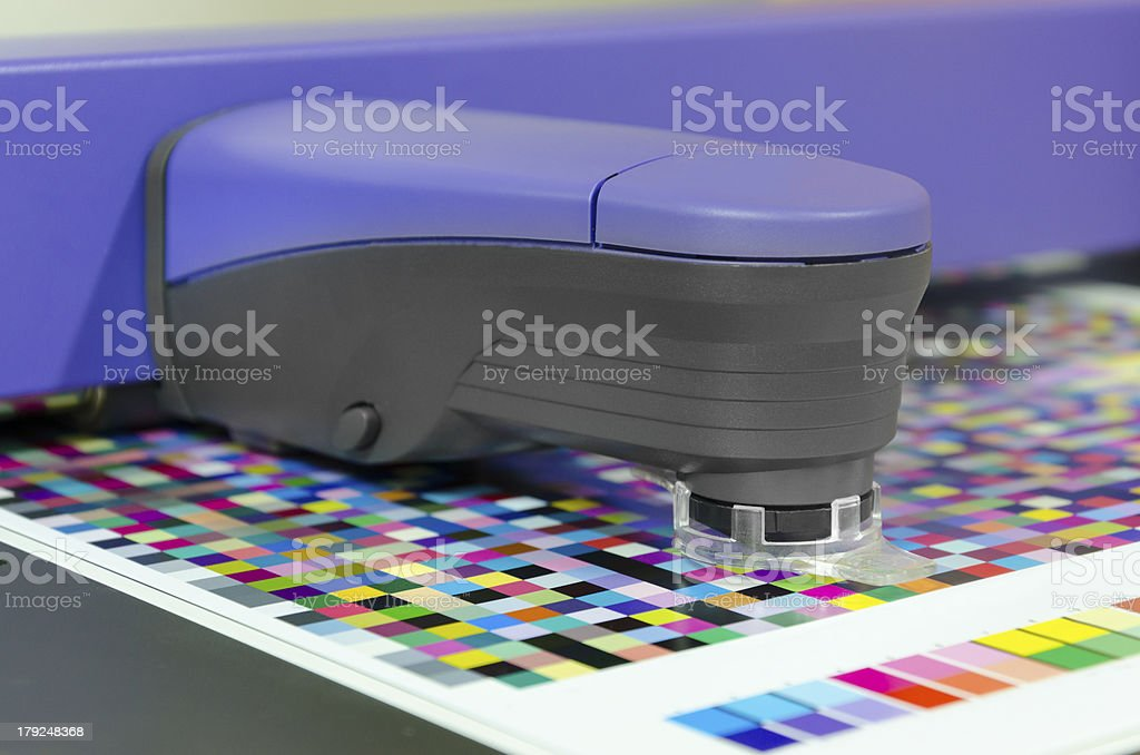 icc profiling, spectrophotometer robot measures color patches on Test Arch royalty-free stock photo