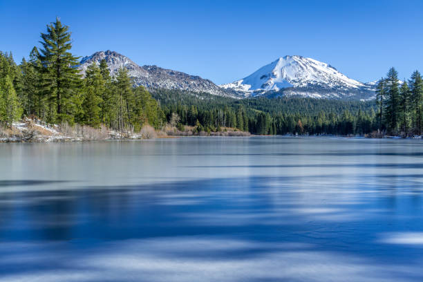 ice and shadows on frozen manzanita lake - snowy mountains stock photos and pictures