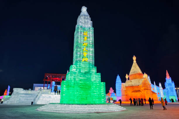 Ice and Snow World, Harbin, China December 27, 2018, Colorful illuminated tower scultpures in ice and snow world, Harbin, Heilongjiang Province, China harbin ice festival stock pictures, royalty-free photos & images
