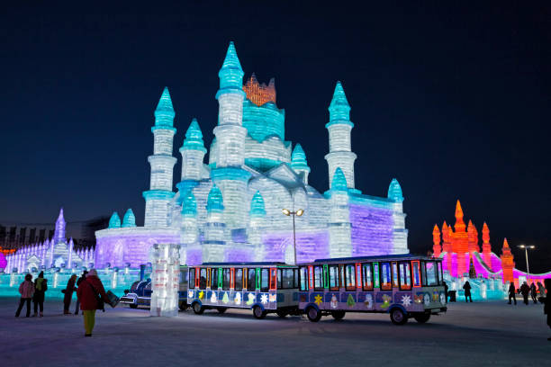 Ice and Snow World, Harbin, China December 27, 2018, A colorful illuminated train in ice and snow world, Harbin, Heilongjiang Province, China harbin stock pictures, royalty-free photos & images