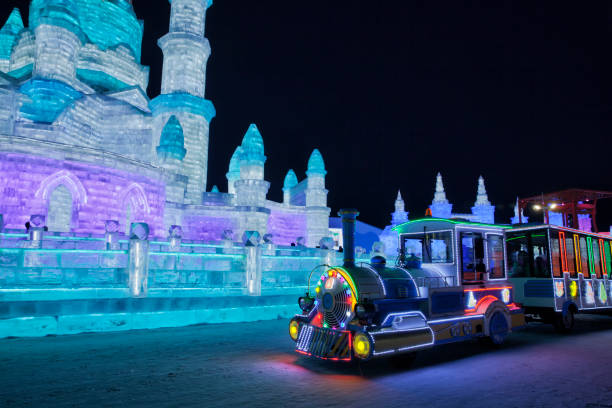 Ice and Snow World, Harbin, China December 27, 2018, A colorful illuminated train in ice and snow world, Harbin, Heilongjiang Province, China harbin ice festival stock pictures, royalty-free photos & images