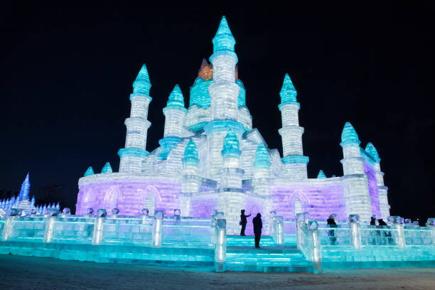 Ice and Snow World, Harbin, China December 27, 2018, A colorful illuminated castle scultpure in ice and snow world, Harbin, Heilongjiang Province, China harbin ice festival stock pictures, royalty-free photos & images