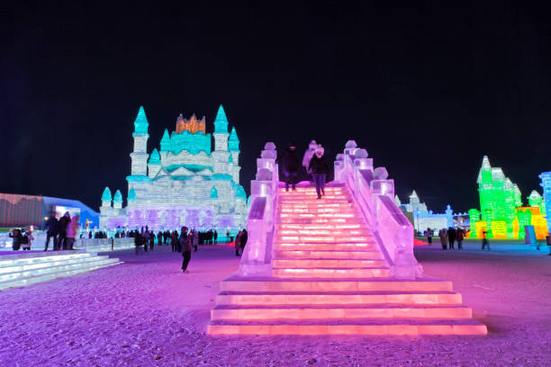 Ice and Snow World, Harbin, China December 27, 2018, Colorful illuminated sculptures in ice and snow world, Harbin, Heilongjiang Province, China harbin ice festival stock pictures, royalty-free photos & images