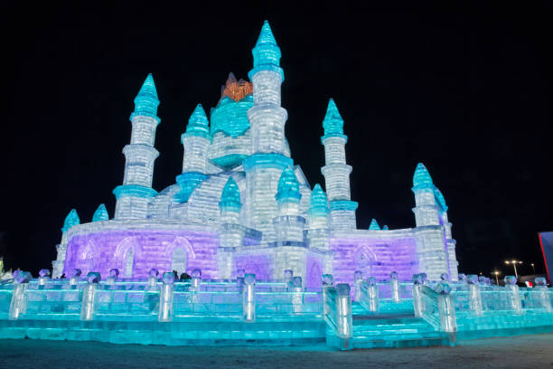 Ice and Snow World, Harbin, China December 27, 2018, A colorful illuminated castle in ice and snow world, Harbin, Heilongjiang Province, China harbin ice festival stock pictures, royalty-free photos & images