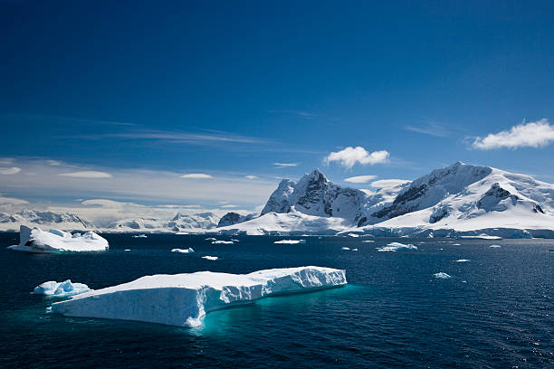 Ice and snowy mountains with water in the Paradise Harbour stock photo