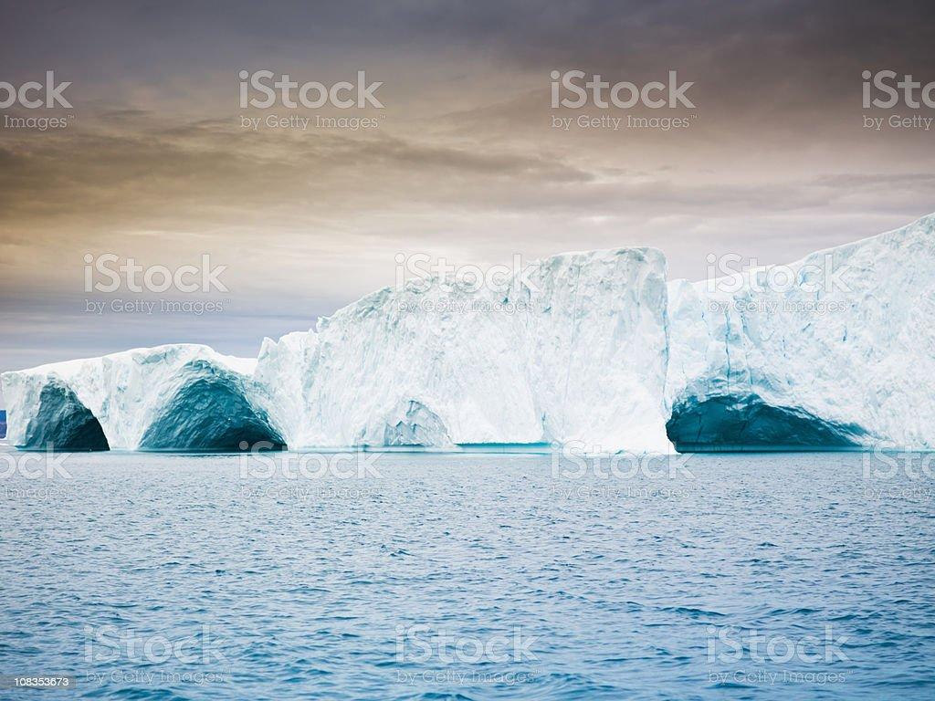 Ice Arch in Iceberg Greenland Twilight Scene  Arctic Stock Photo