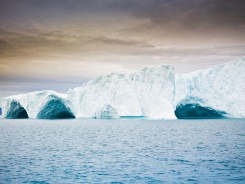 Ice Arch In Iceberg Greenland Twilight Scene Stock Photo - Download Image Now