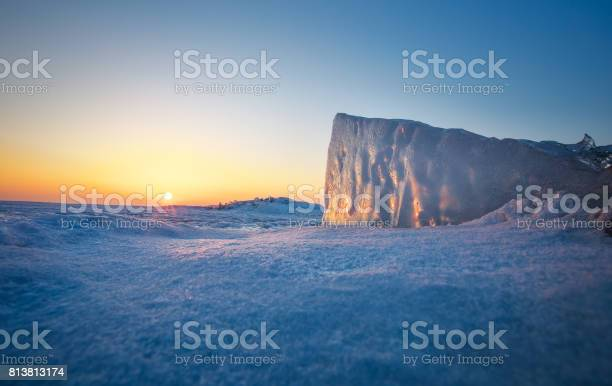 Photo of Ice block closeup during sunset. Image taken on a ice by the lake.