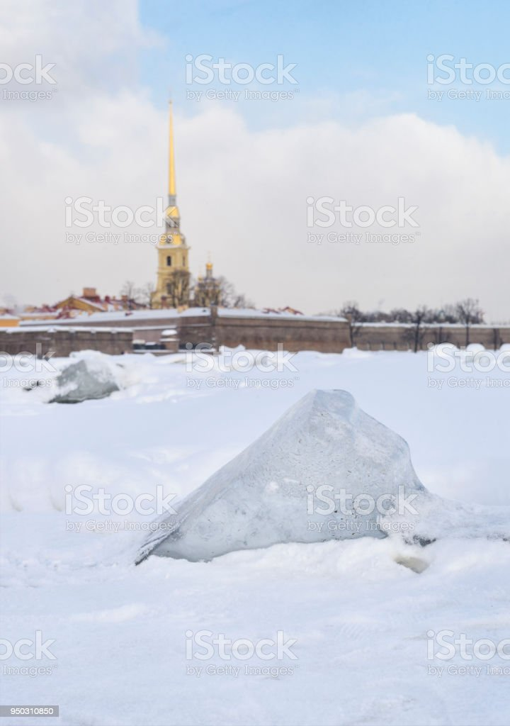 ice block on the river Neva on the background of Peter and Paul fortress, view of St. Petersburg, snow, winter landscape stock photo