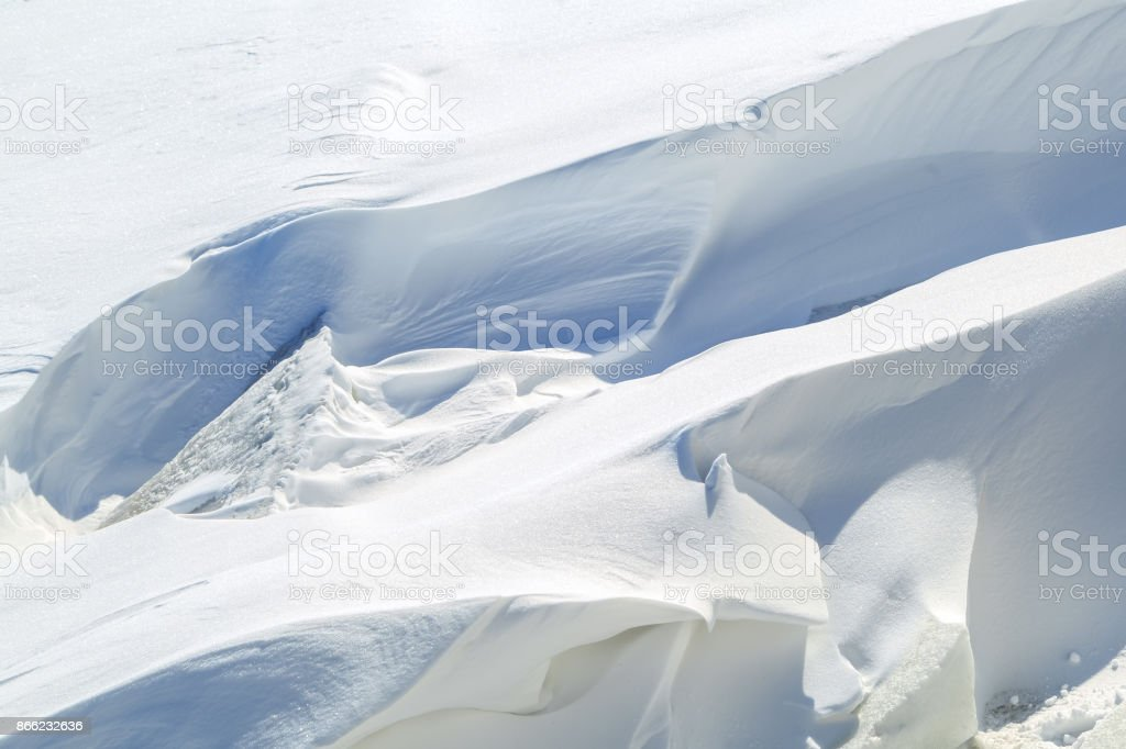 Ice blocks and freakish snowdrifts on a winter sunny day stock photo