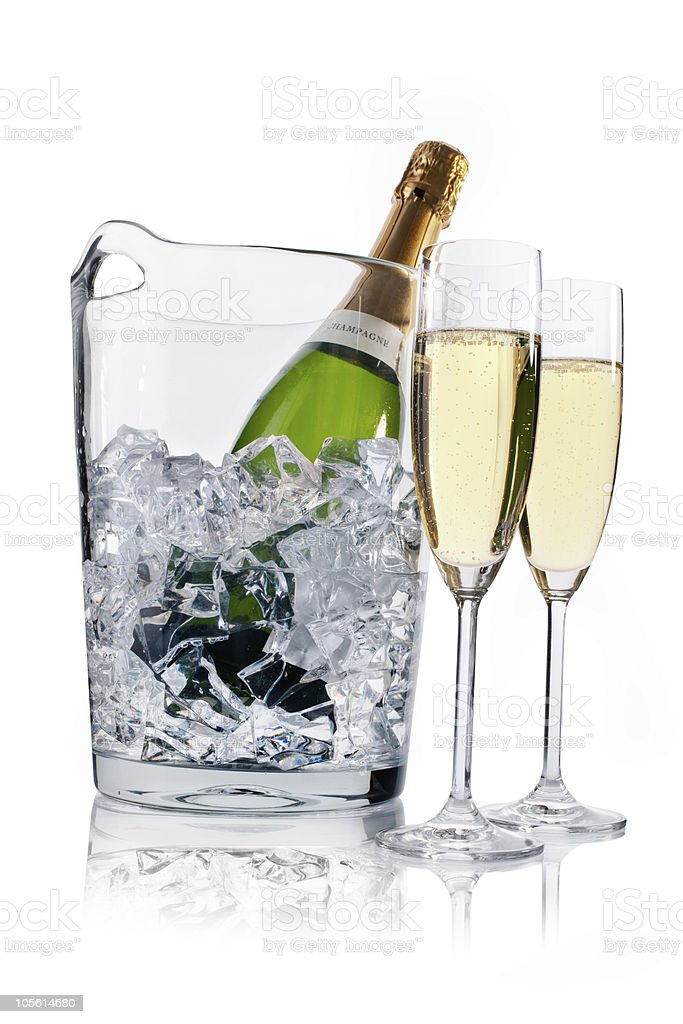 Ice bucket with ice chilling champagne and two glasses royalty-free stock photo