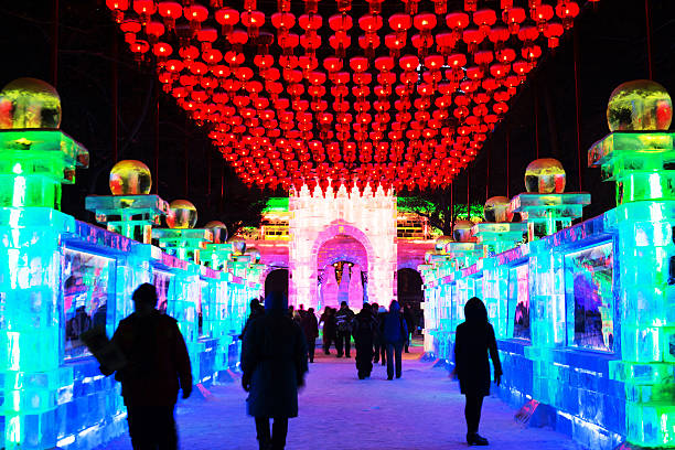 Ice building Harbin, China - December 27, 2013: Ice building of Harbin Ice-Lantern Show. People are walking. Located in Harbin City, Heilongjiang Province, China. harbin stock pictures, royalty-free photos & images