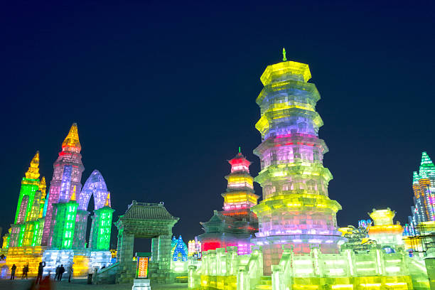 Ice building Harbin, China - December 30, 2013: Harbin Ice and Snow World. People are walking. Located in Harbin City, Heilongjiang Province, China. harbin stock pictures, royalty-free photos & images