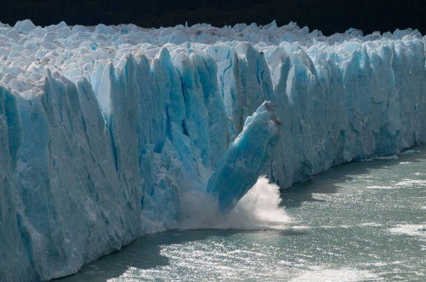 Ice Calving at Perito moreno Glacier A giant piece of Ice breaks off the Perito Moreno Glacier in Patagonia, Argentina glacier lagoon stock pictures, royalty-free photos & images