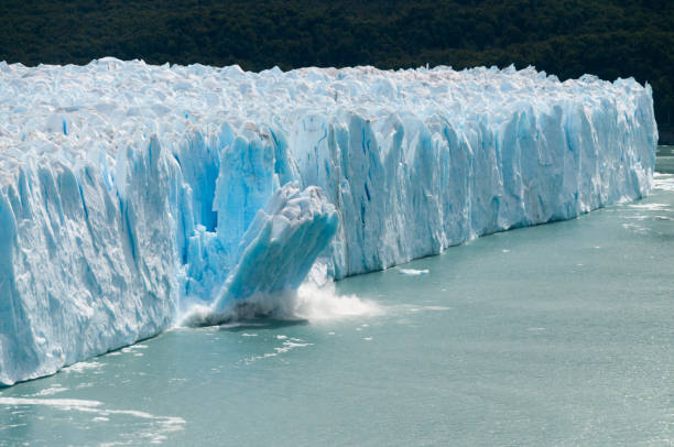 Ice Calving at the Perito Moreno Glacier A giant piece of Ice breaks off the Perito Moreno Glacier in Patagonia, Argentina collapsing stock pictures, royalty-free photos & images