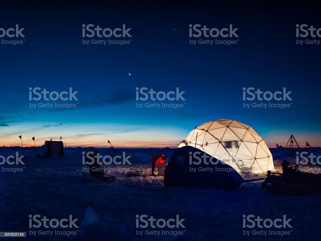 Ice camp at night stock photo