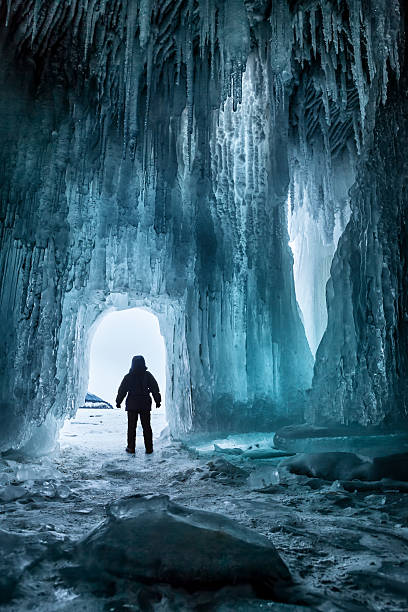 Ice cave and tourist stock photo
