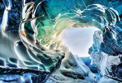 Looking out of the ice cave of Breidamerkurjokull in southern Iceland, showing the beautiful colours and details of the ice.