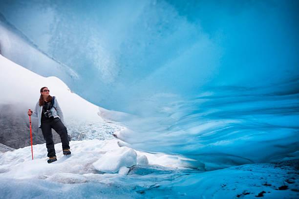 ice climber on franz josef glacier, new zealand - アイスクライミング ストックフォトと画像