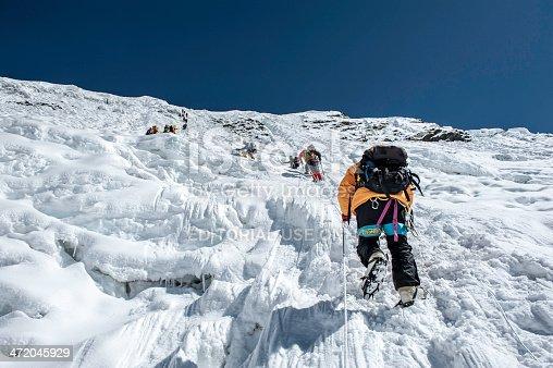 istock Ice climbing 472045929