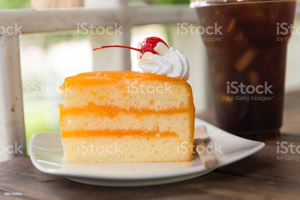 Ice coffee and orange cake on wood table, - Lizenzfrei Abnehmen Stock-Foto
