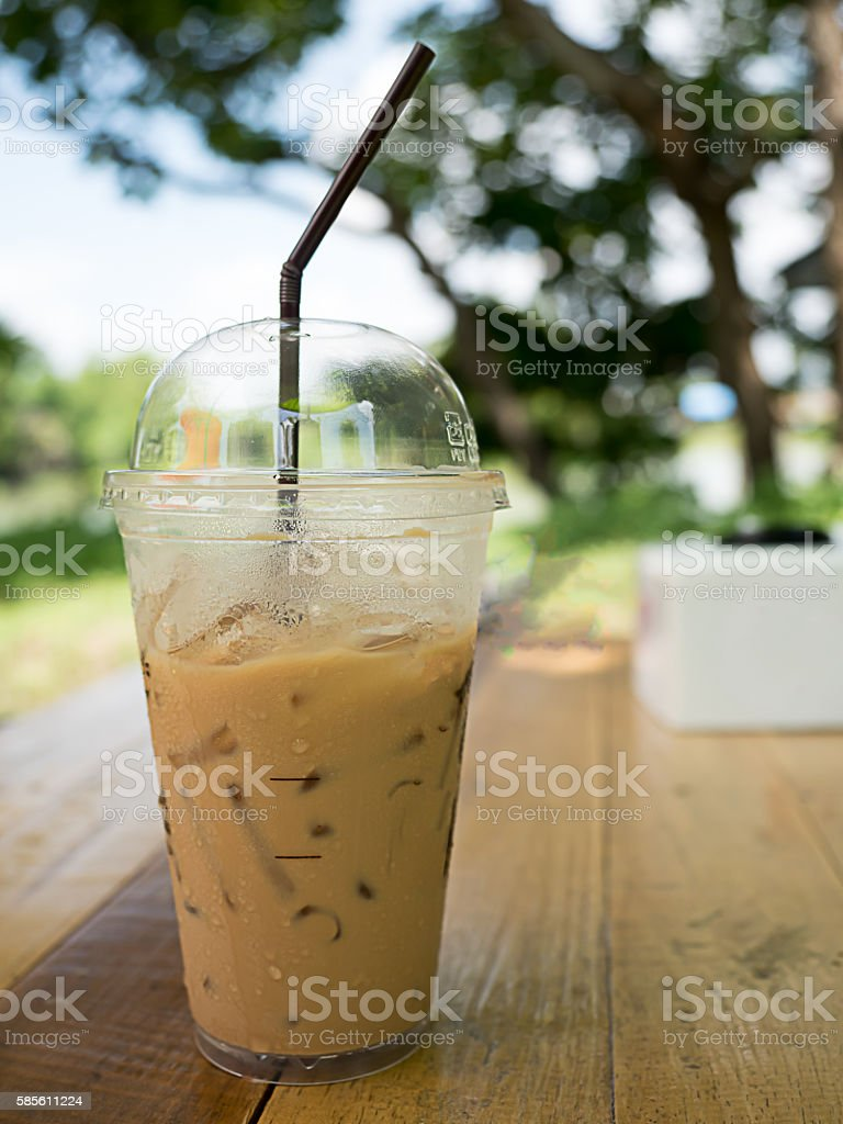 ice coffee on wooden in the garden stock photo