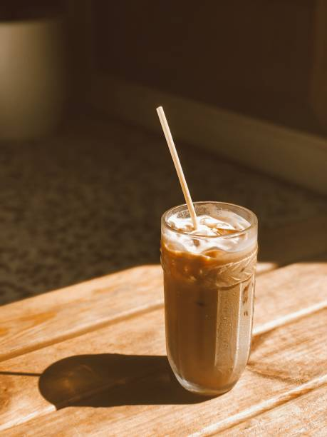 Ice coffee with milk on a sunny day stock photo