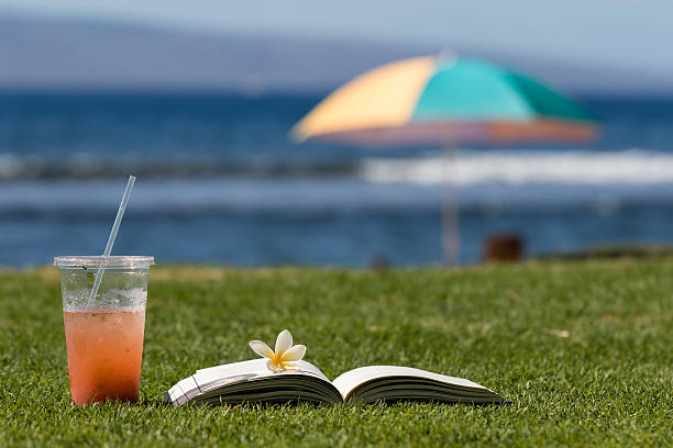 Ice Cold Drink and Book on Beach stock photo